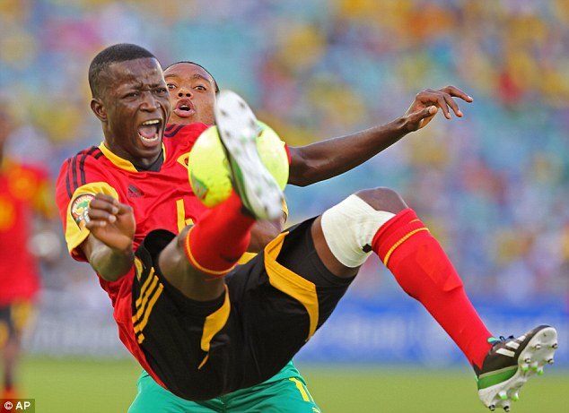 He's behind you: Angola's Dany Massunguna is challenged by Siphiwe Tshabalala