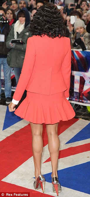 Leggy: Alesha wore a red skirt suit and high-necked white shirt