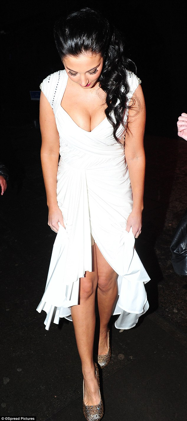 Oops! Tulisa looks like she may have realised her fashion faux pas, luckily before she hit the red carpet