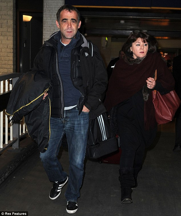 Grumpy: Michael Le Vell, who plays grease monkey Kevin in Coronation Street, looked angry as he walked through the station