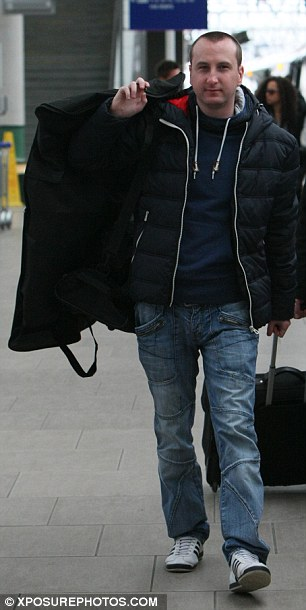 Triumphant return: Andy Whyment was ready to brave the Manchester chill in a puffa jacket