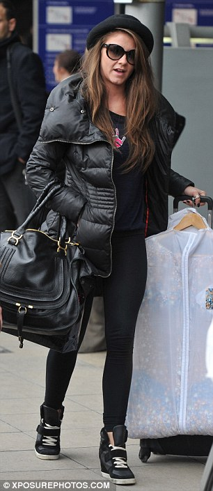 Back to work: Brooke wore a cute black hat for her journey home