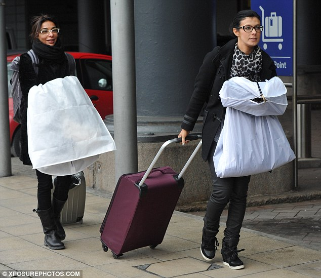 Back on home turf: Kym Marsh and Shobna Gulati return to Manchester after their triumphant night at the awards