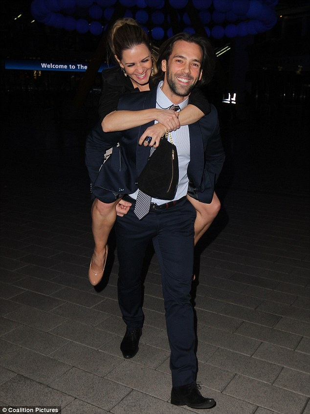 Having fun: While Samia looked distracted Sylvain gave a friend a piggy back ride