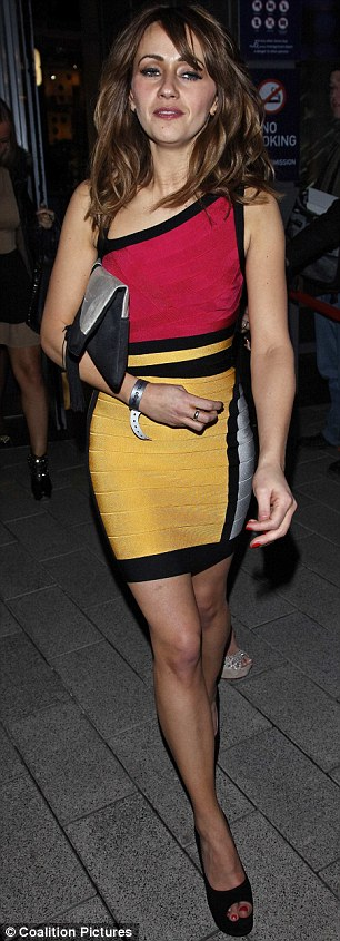 Body con: Samia looked great in a hot pink, yellow and white block coloured skin tight dress