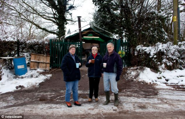 Villagers campaigning against an illegal gypsy camp on greenbelt land today mark 1,000 days of their blockade of the site. Supporters Maz Crawley, Maureen Taylor and Ken Hughes are pictured