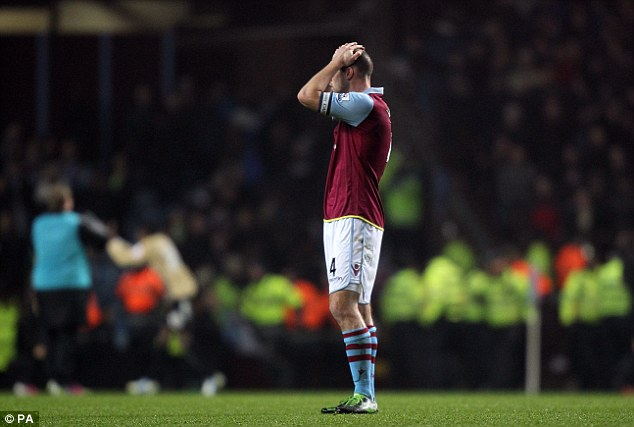 Trepidation: Ron Vlaar may be fearful as he takes his Aston Villa team to play another lower league team at Millwall