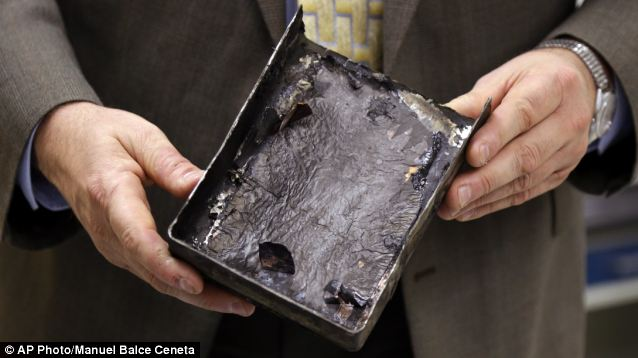 Damage: National Transportation Safety Board's Joseph Kolly, holds a fire-damaged battery casing from the Japan Airlines Boeing 787 Dreamliner