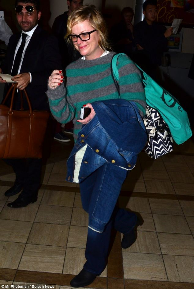 Dressed down: Actress Amy Poehler touches down in Los Angeles after jetting in from the Sundance Film Festival