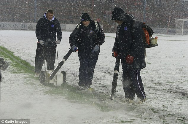 Desperation: Hylton helped clear snow ahead of the home game against Northampton to avoid his suspension being carried into their FA Cup tie