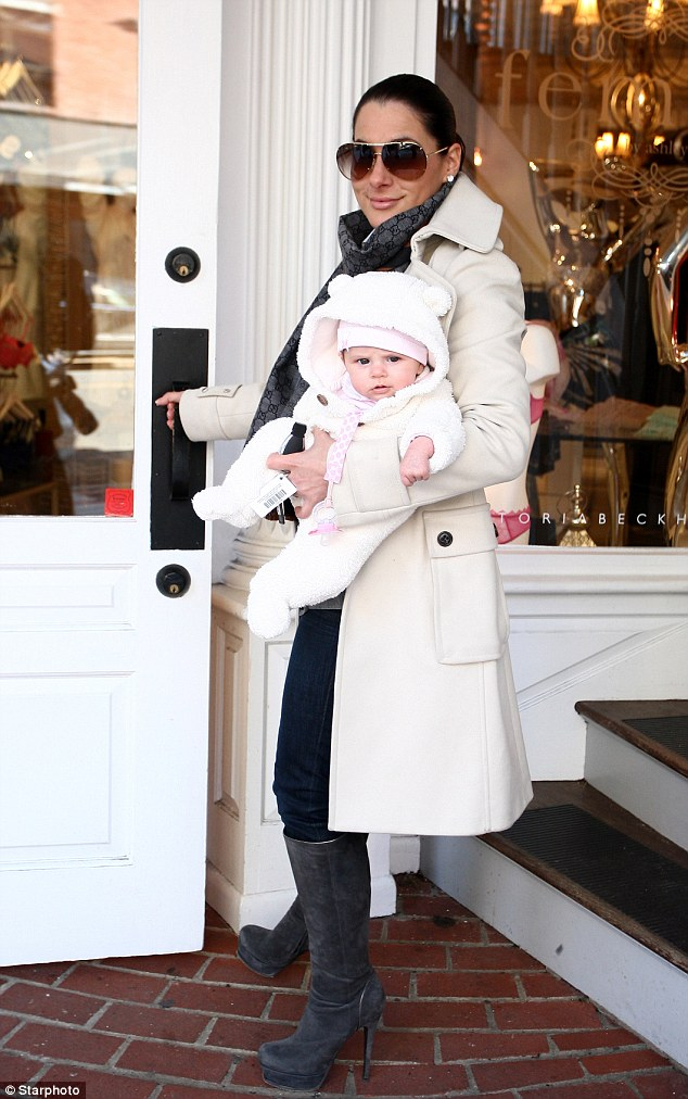 Baby love: Miss Dupré, who now runs a lingerie boutique, has bounced back into shape since having her baby girl Izabel Jagger just over two months ago