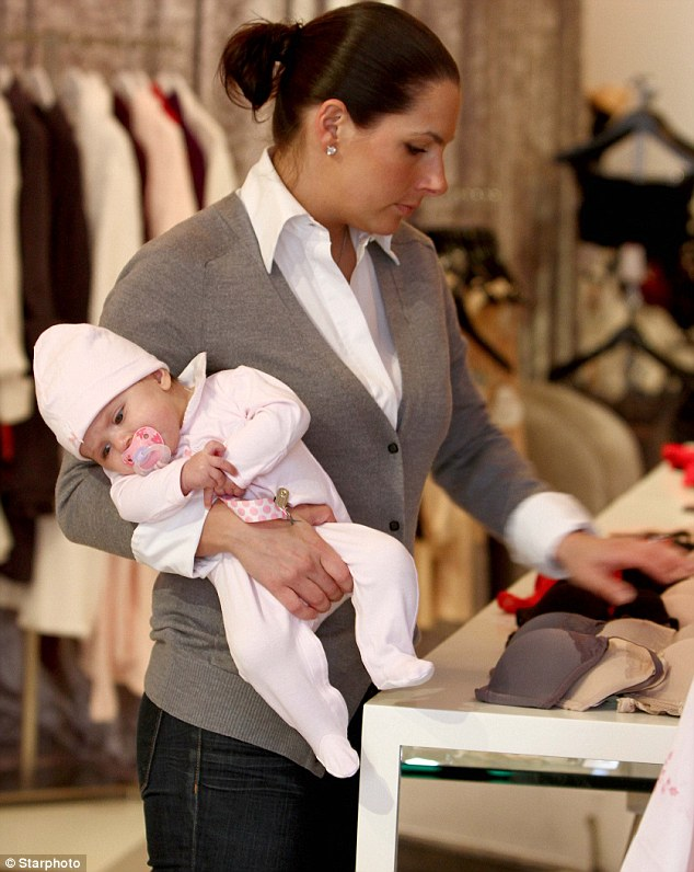For sale: Ashley Dupré surveys the merchandise at her store in Red Bank in New Jersey