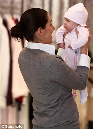 New mommy: Ashley looked contented in her new role with baby girl Izabel