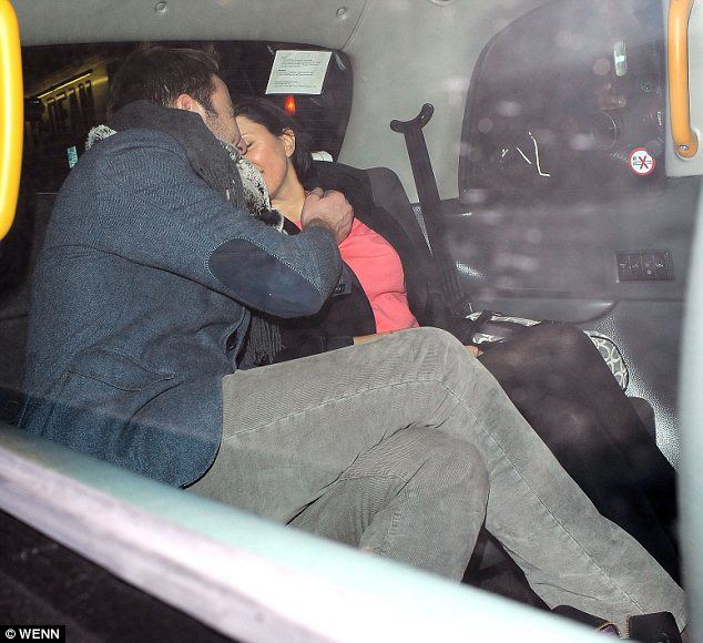 Whispering sweet nothings: The pair were seen giggling together following the night out at Groucho club