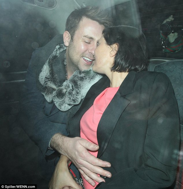 Hands on: Sadie's male companion proved to be quite a tactile fellow and was seen cuddling her in the back of the taxi