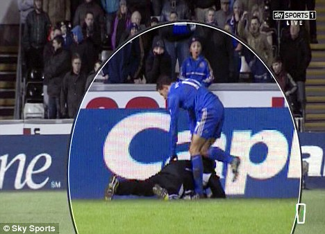 Give me that: Hazard jabs his foot in to try and dislodge the ball