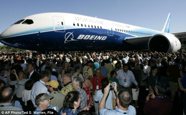 Hopes: Visitors admired the first production model of the Boeing 787 Dreamliner when it was unveiled to an audience of several thousand at Boeing's assembly plant in Everett, Washington