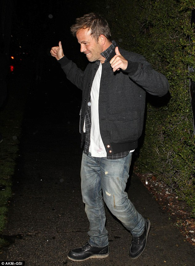 Unfazed: The star doesn't seem bothered about being spotted and gives a thumbs up as he heads to his car