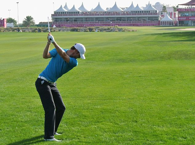 In the swing: Chris Wood plays his second shot on the 18th hole
