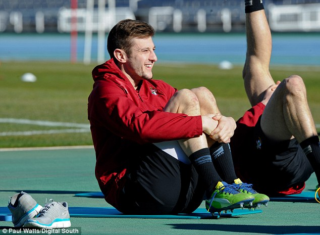 Backing the boss: Adam Lallana returning to full training following a knee injury says Pochettino will be a sucess