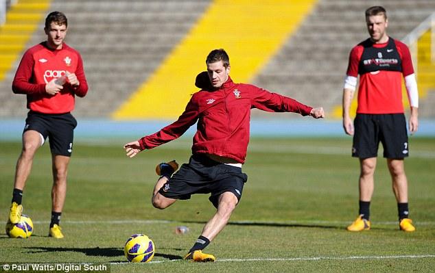 Strike it lucky: Morgan Schneiderlin has a shot during training in Spain