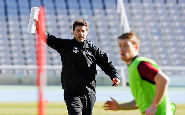 New man in charge: Mauricio Pochettino during training with the Saints in Barcelona