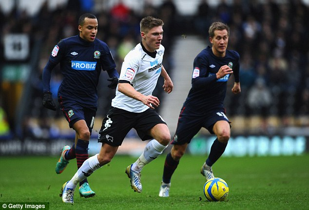 Chase is on: Derby's Jeff Hendricks manoeuvres the ball away from Blackburn's Morten Gamst Pedersen