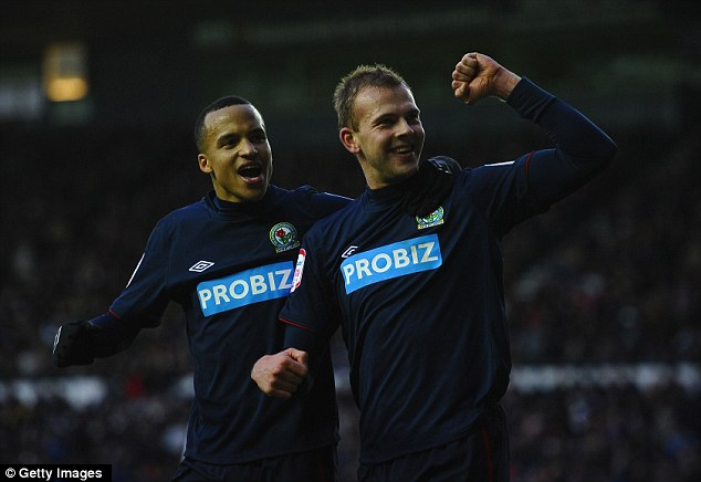 Stroll: Jordan Rhodes (right) celebrates with Martin Olsson after his third goal secured Blackburn's passage into the fifth round of the FA Cup