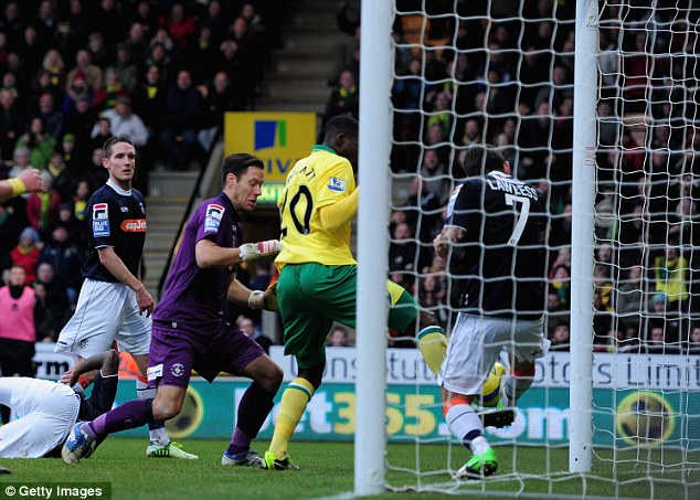 Off the line: Alex Lawless of Luton Town hacks the ball away from his goalmouth