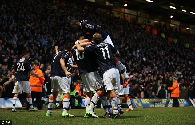 Mobbed: Rendell is congratulated by his team-mates after bagging the winner