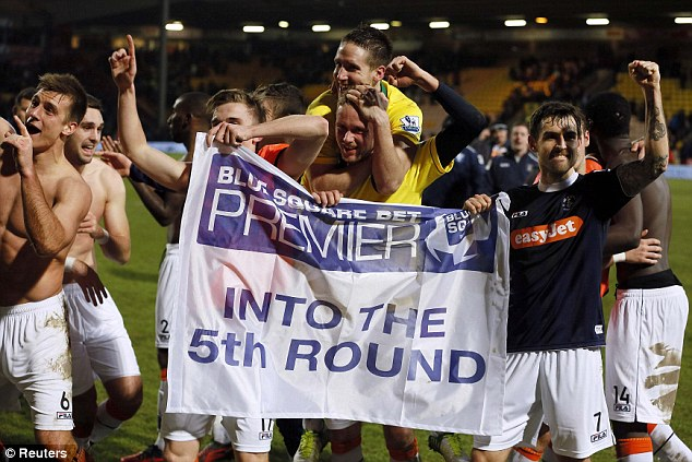 Pure delight: Luton Town players celebrate after turfing Norwich out of the FA Cup