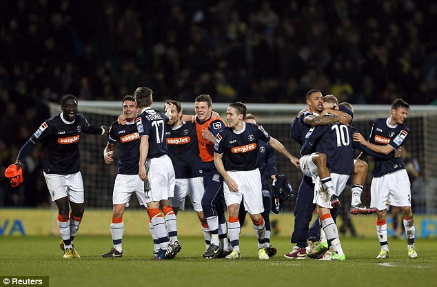 Luton celebrate after the final whistle