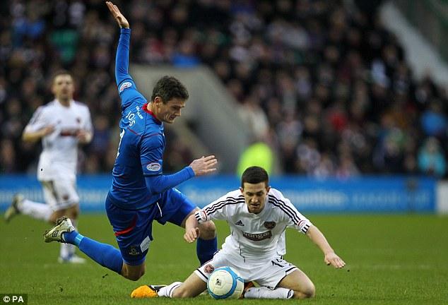 Tussle: Jason Holt and Inverness' Owain Tudor Jones (left) battle for the ball