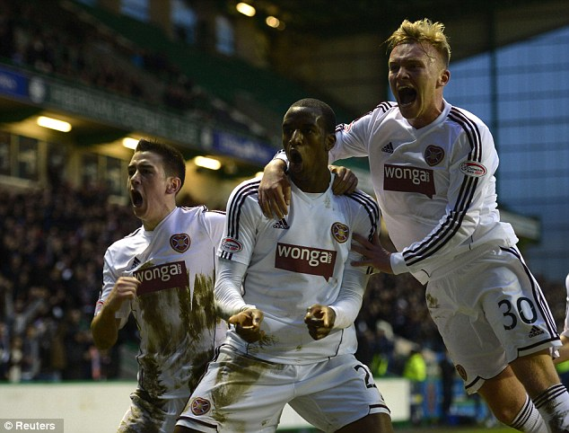 On target: Hearts' Michael Ngoo (centre) celebrates his goal with Jamie Walker (left) and Fraser Mullen