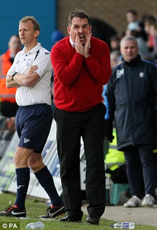Barking the orders: Gillingham Manager Martin Allen shouts instructions during the match