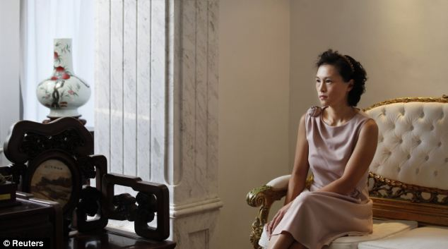 'Young and beautiful': Gigi Chao, the daughter of Hong Kong property tycoon Cecil Chao Sze-tsung, poses at the conference room of her office in Hong Kong