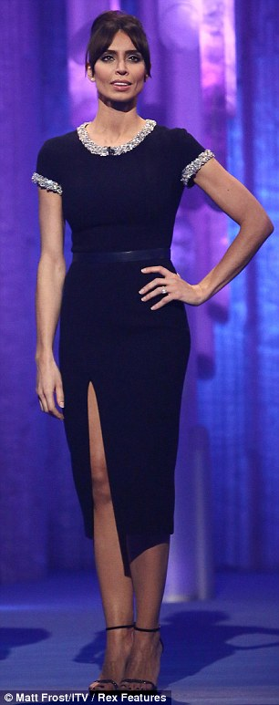 Prim and proper: Host Christine Bleakley went for an up 'do as she wore a black dress with a slit