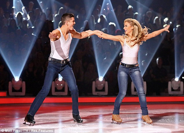 Matching: The pair glided around in their routine outfits before hearing the feedback