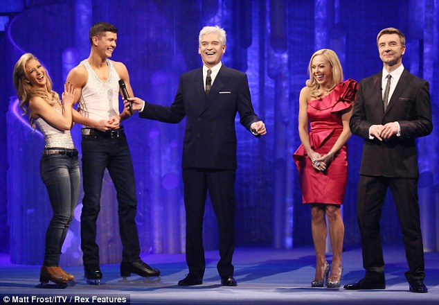 At least they're all smiling: Jane Torvill dressed up in read as she joined Christopher Dean for yet more feedback