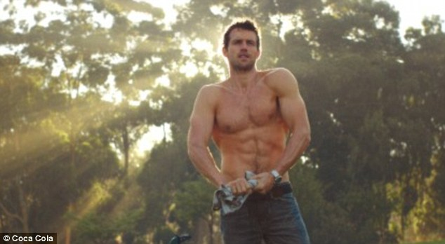 Topless: Soaking wet, the hunk is forced to remove his shirt revealing a perfect six pack in the process