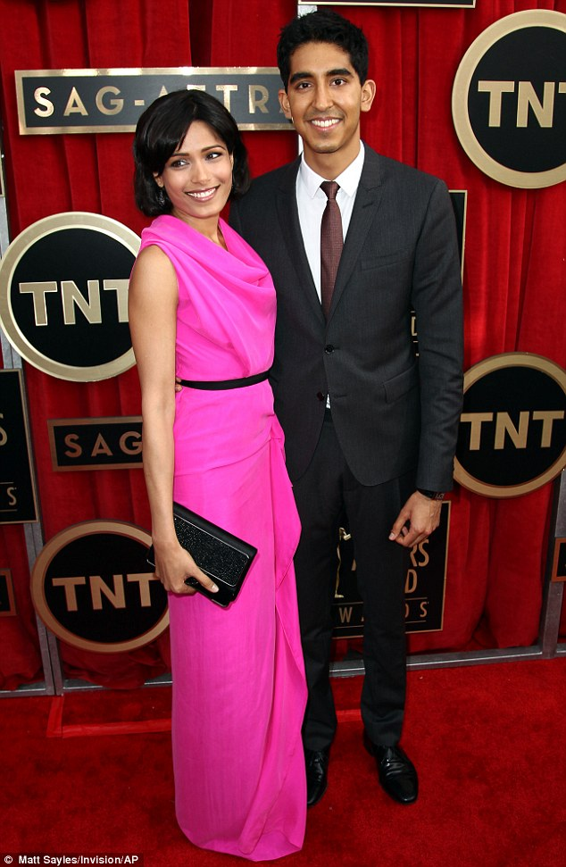 Cute couple: British actor Dev Patel posed alongside his girlfriend, Freida Pinto, at the annual ceremony