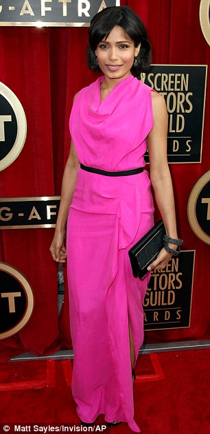 Belles of the ball: Freida wowed in a fuchsia number, while Kelly Osbounre chose a demure black floor-skimming gown