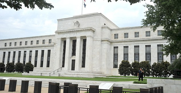 Waiting game: Investors are biding their time as they await the latest policy decision of the US Federal Reserve (pictured) as well as the start of the UK earnings season.
