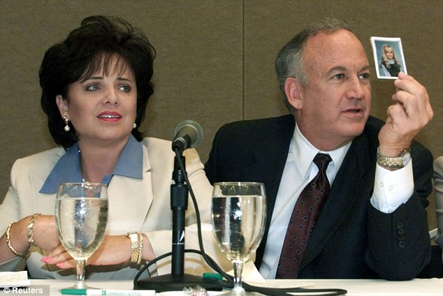 Defending accusations: Patsy and John Ramsey hold a picture of their daughter during a press conference in 2000 where they released the results of an independent lie detector test, which revealed they had no knowledge of who killed their daughter