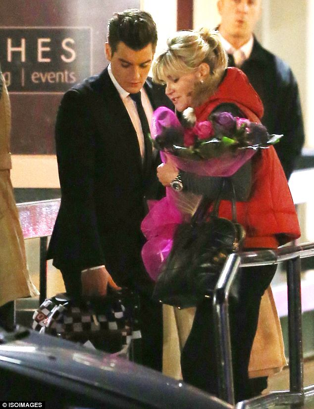 Helping hand: Matt Lapinskas showed what a gentleman he is as he carried the TV stars bags to the car for her