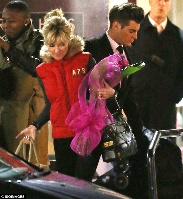 Well done: Anthea carried a large bouquet of flowers with her as she left the ITV studio