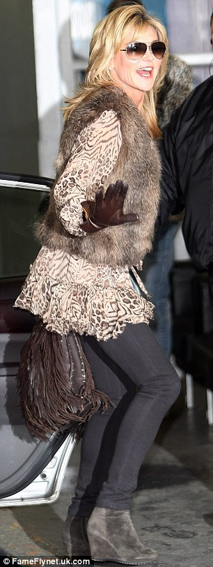 The morning after: Anthea didn't look too upset as she arrived at ITV on Monday morning
