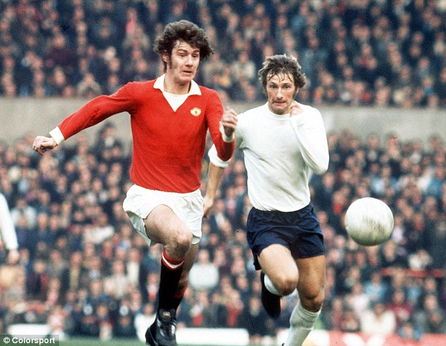 Playing days: Brian Kidd, now a coach at Manchester City, in action for Manchester United in the 1970s. He's in a race with Colin Todd of Derby County