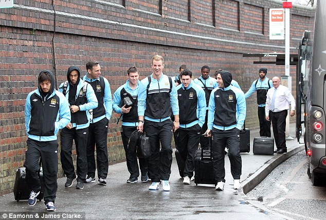No sign of Mario: Manchester City players arrive at the station ahead of their game against QPR