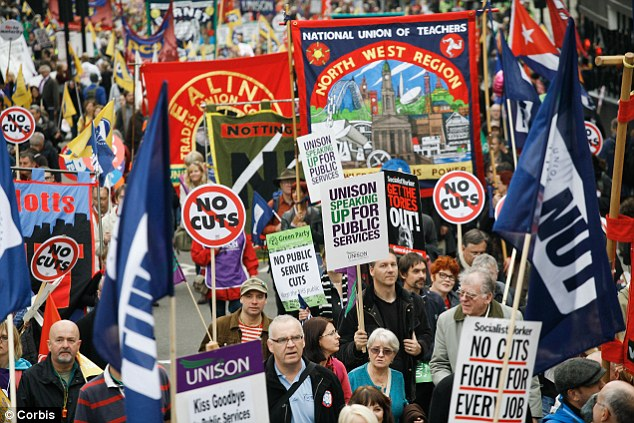Resistance: Thousands marched against public service cuts - which lead to redundancies - in London last yea